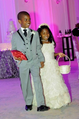 Syre Stewart holding hand of African American flower girl