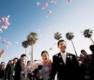 Bride and groom exit outdoor wedding together