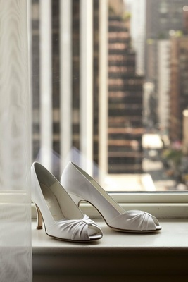 Bride's white peep-toe heels