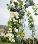 Outdoor wedding ceremony structure with branches and flowers