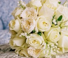 Bouquet with ivory rose and white lily of the valley flowers