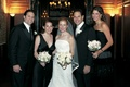 Two bridesmaids and one groomsman with couple