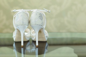 White Jimmy Choo wedding shoes with ankle strap and lace