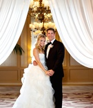 Blonde woman in wedding dress and man in tuxedo