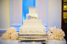 Square white cake with metallic details