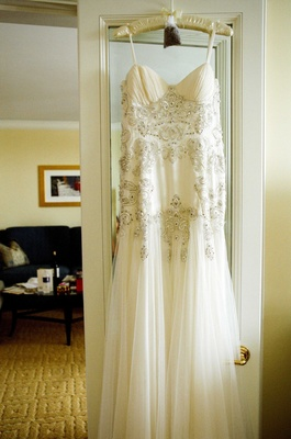 Bead bodice bridal gown hanging in bridal suite