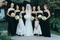 bride poses with bridesmaids and flower girls