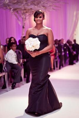 African American bridesmaid walking down aisle