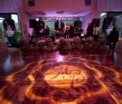 Floral-embellished stage and monogram lighting