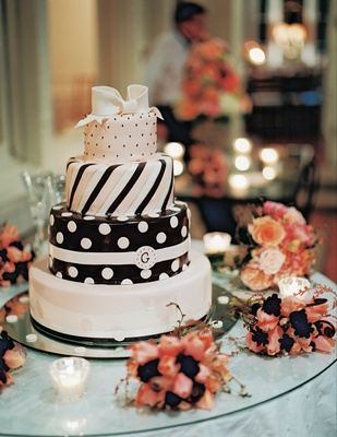 Four layer pink and brown cake with stripes and polka dots