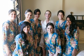 Bride and bridesmaids getting ready in matching robes