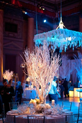 Winter wedding icy tree branch centerpiece with candles