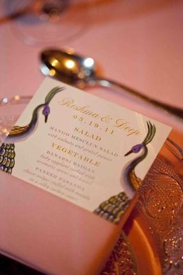 Wedding reception menu with peacocks by Ceci New York