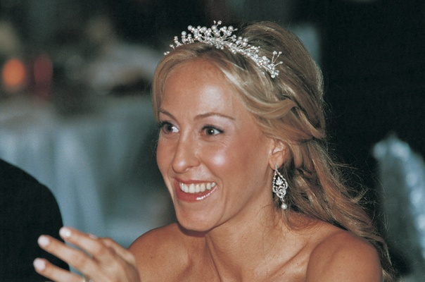 Bride wears glistening tiara and earrings