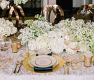 Wedding reception table, Luxe Linen's Bellisimo Collection's Ivory Monaco tablecloth, white flowers