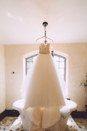 Tara Keely strapless wedding dress in front of bathtub
