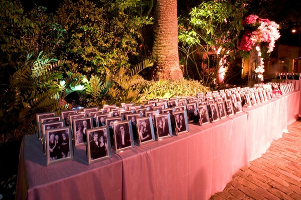 Table with photos of guests in silver frames