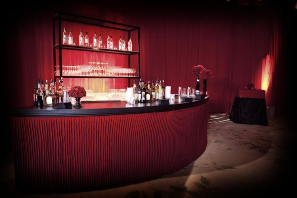 Semi-circle round bar with crimson drapery