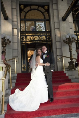 Bride in a Romona Keveza dress and veil with groom in black tuxedo at the Plaza Hotel