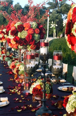 Black candelabra centerpiece and vibrant flowers