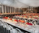 White and grey drapery around reception room with white and pink decorations