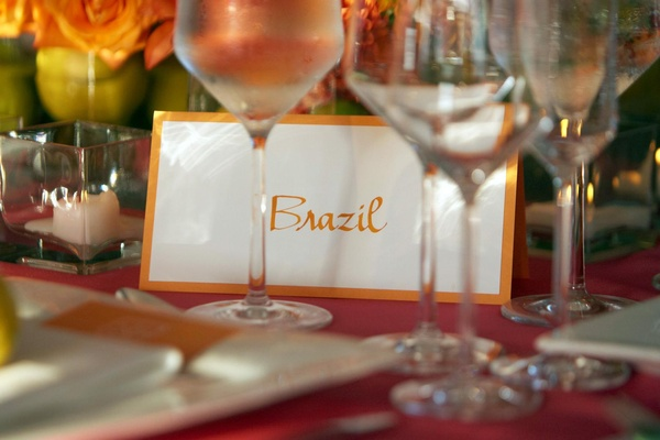 Wedding reception table with orange Brazil table name