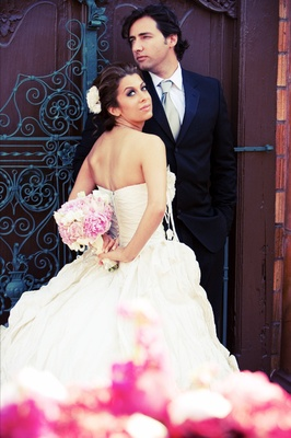 Persian couple on wedding day holding bouquet