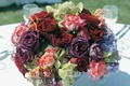 Reception centerpiece with red, purple, and pink roses