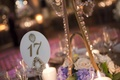 Wedding reception table number with The Plaza logo