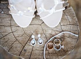 Rustic wedding diamond jewelry on tree trunk