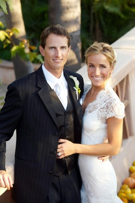 Pinstripe suit groom with lace wedding dress bride