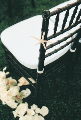 black chiavari chair accented with tiny white seashell