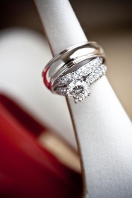 Round-cut diamond ring and silver wedding band