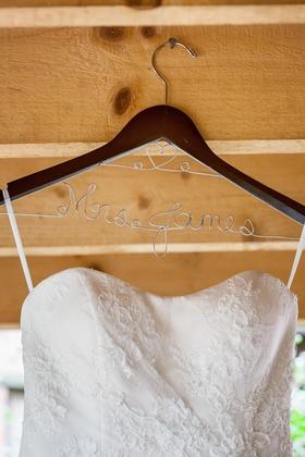 Strapless wedding dress hanging on custom hanger