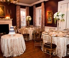 Small wedding in restaurant with damask print linens