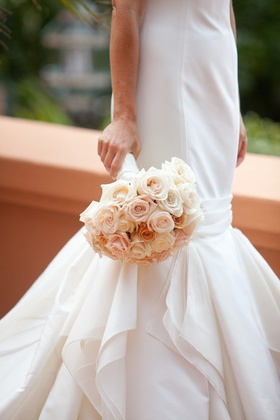 Mermaid wedding dress and peach and salmon flowers