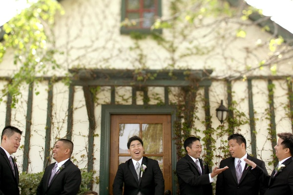 Groom with groomsmen in front of vineyard home