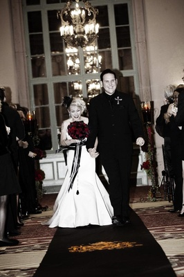Brandon Saller, drummer of Atreyu, with bride in a stapless Alvina Valenta dress with a black sash