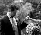 Black and white photo of the bride in a Claire Pettibone gown and groom in a pinstripe suit and tie