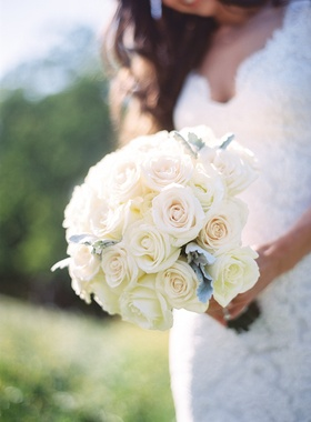 Rustic wedding bouquet with roses and dusty miller