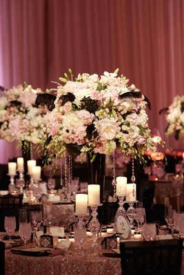 Crystal-embellished details and black feather centerpiece