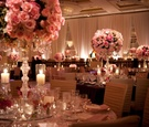 Gold chair covers and blush roses in candelabra