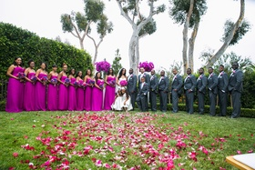 bridal party with pink dresses and groomsmen in gray suits
