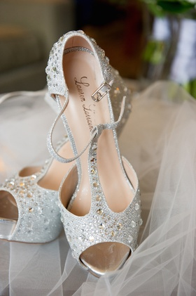 Pumps with ankle strap and rhinestone embellishments