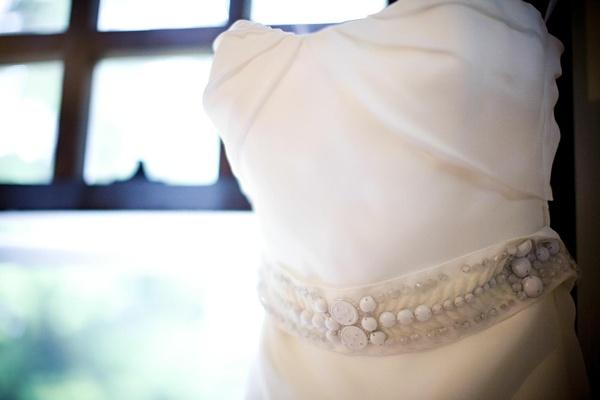 white beaded belt on strapless gown