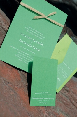 Bright rectangular invites tied with raffia