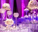 Clear Lucite chairs and white rosette linens