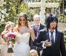 Courtney Bingham and Nikki Sixx after wedding ceremony