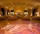 Monogram dance floor and chandliers