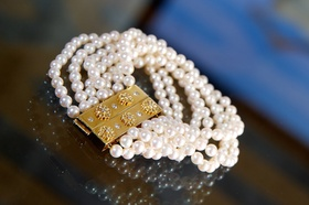 Seven strands of pearls attached to gold clasp